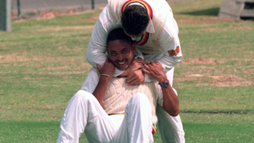 Phil DeFreitas gets tackled by Darren Gough during training