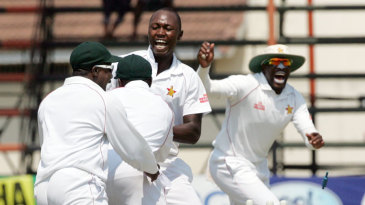 The Zimbabwe players erupt in celebration after defeating Pakistan