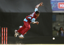 Dilhara Lokuhettige delivers the ball, Faisalabad Wolves v Kandurata Maroons, Champions League Qualifiers, Mohali, September 20, 2013