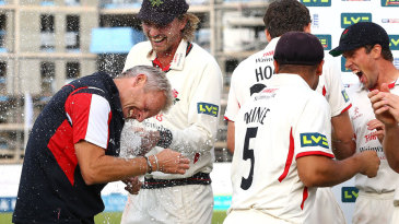 Peter Moores gets a soaking after Lancashire wrapped up the title