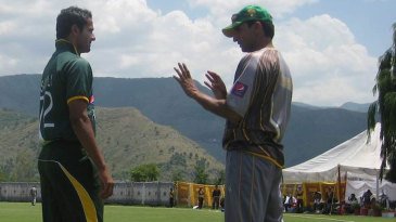 Mohammad Akram instructs one of his wards amid a magnificent backdrop