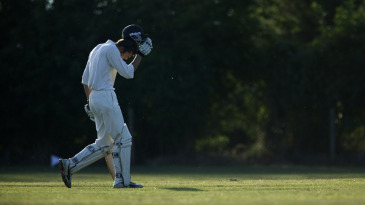 A village cricketer walks off the field