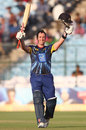 Neil Broom raises the bat after reaching his century, Otago Volts v Perth Scorchers, Group A, Champions League 2013, Jaipur, September 25, 2013
