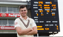 Dominic Sibley poses next to the scoreboard showing his innings, Surrey v Yorkshire, County Championship, Division One, The Oval, September 27, 2013