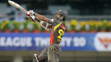 Shikhar Dhawan is airborne while attempting an off-side shot