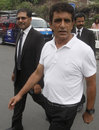 Asad Rauf leaves the press conference with his lawyer Syed Ali Zafar, Lahore, September 27, 2013