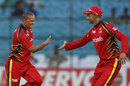 Ethan O'Reilly celebrates a wicket with Alviro Petersen, Lions v Otago, Group A, Champions League 2013, Jaipur, September 29, 2013