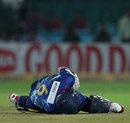 Ian Butler is on the ground after being struck by a full toss, Lions v Otago, Group A, Champions League 2013, Jaipur, September 29, 2013