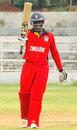 Clive Chitumba raises his bat after hitting fifty, India U-19s v Zimbabwe U-19s, Visakhapatnam, September 29, 2013