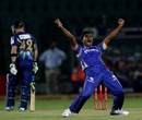 Rahul Shukla celebrates one of his three wickets, Rajasthan Royals v Otago, Champions League 2013, Jaipur, October 1, 2013