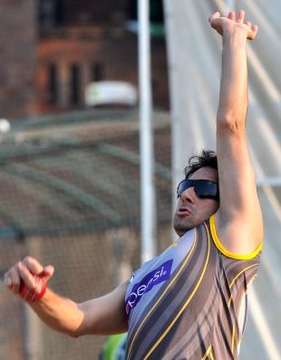 Saeed Ajmal bowls in a training session, Lahore, October 1, 2013