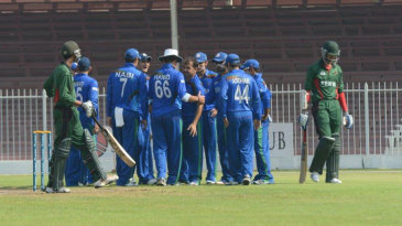 Offspinner Karim Sadiq celebrates with team-mates after taking a wicket