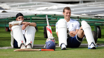 Monty Panesar and Chris Tremlett look on during a training session