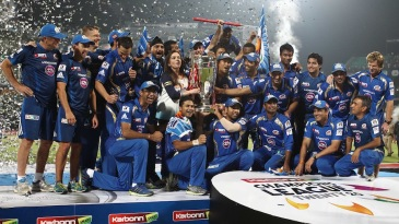 Mumbai Indians pose with the Champions League trophy