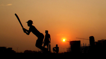 Youngsters play street cricket in Mumbai