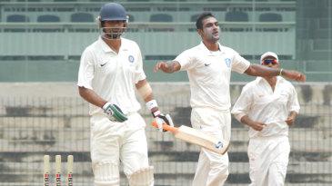 Abhimanyu Mithun celebrates the wicket of Mohammad Kaif