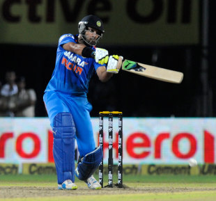 Yuvraj Singh bludgeons through the off side, India v Australia, one-off T20, Rajkot, October 10, 2013