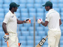 Robiul Islam and Sohag Gazi bump fists during their 105-run partnership, Bangladesh v New Zealand, 1st Test, 4th day, Chittagong, October 12, 2013