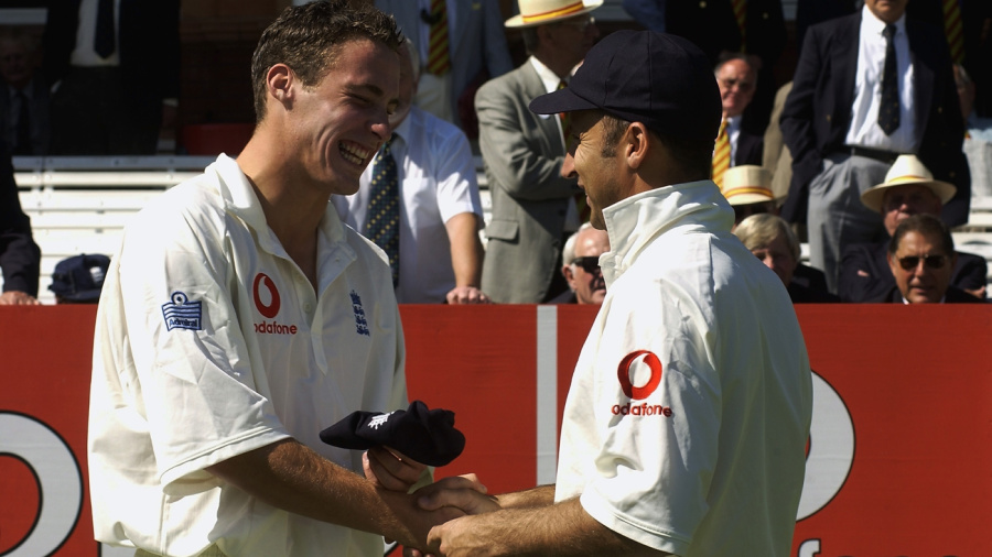 Simon Jones grins from ear to ear on getting his Test cap from his captain Nasser Hussain