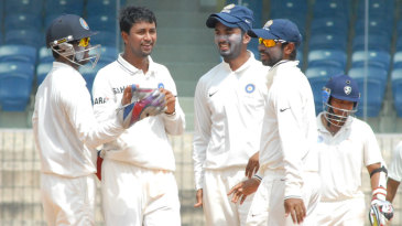 Pragyan Ojha celebrates one of his six wickets