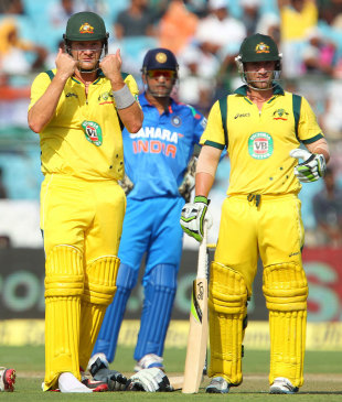Shane Watson gestures to the balcony, while Philip Hughes and MS Dhoni look on, India v Australia, 2nd ODI, Jaipur, October 16, 2013