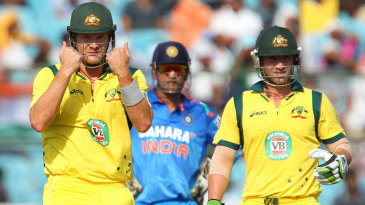 Shane Watson gestures to the balcony, while Philip Hughes and MS Dhoni look on