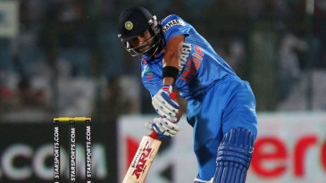 Virat Kohli smacks the ball en route to making India's fastest ODI century