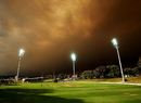 Smoke from New South Wales bushfires bellows over Drummoyne Oval in Sydney, South Australia v Western Australia, Ryobi Cup, Sydney, October 17, 2013