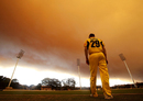 John Rogers watches play under a smoke cloud caused by New South Wales' bushfires, South Australia v Western Australia, Ryobi Cup, Sydney, October 17, 2013