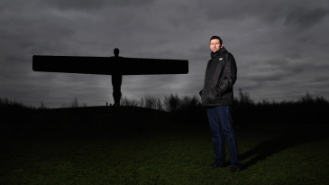 Steve Harmison poses by the Angel of the North