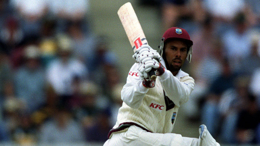 West Indies captain Jimmy Adams sweeps against the Prime Ministers XI
