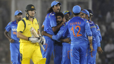 The Indian team celebrates with the World Cup