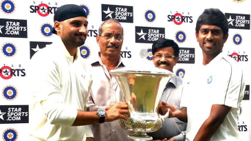 North Zone's Harbhajan Singh and South Zone's Abhinav Mukund collect the Duleep trophy