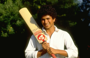 Sachin Tendulkar poses with a bat ahead of his first international tour, to Pakistan, October 1, 1989