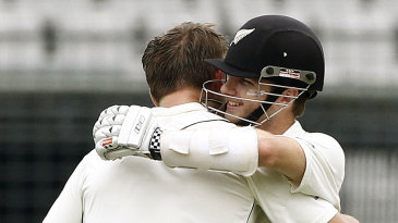 Kane Williamson hugs Corey Anderson after the latter scored his first Test century