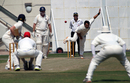 KCC's Roy Lamsam bowling in the 2013 Fincher Shield at Kowloon Cricket Club, 26-27th October 2013