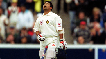 Sachin Tendulkar looks up at the skies after reaching his hundred