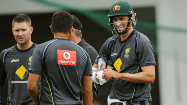 Michael Clarke (left), and Michael Hussey (first from right) speak to team-mates at a training session