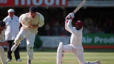 Mike Atherton tries to avoid being hit by a Brian Lara shot