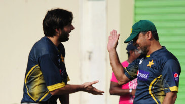 Shahid Afridi and team manager Moin Khan share a lighter moment during training