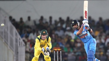 Virat Kohli drives inside out
