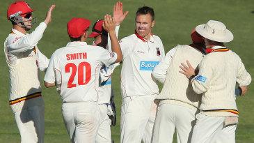 Johan Botha high-fives his teammates