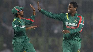 Mominul Haque and Sohag Gazi celebrate James Neesham's wicket