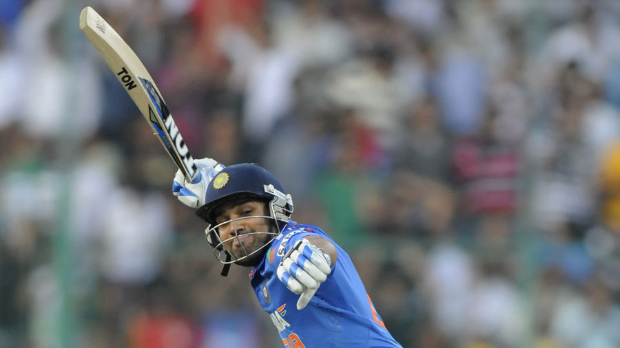 Rohit Sharma exults after reaching his century