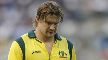 An injured Shane Watson left the field after bowling five overs