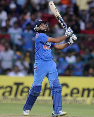 Rohit Sharma watches the ball soar into the evening sky, India v Australia, 7th ODI, Bangalore, November 2, 2013