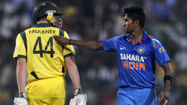 Vinay Kumar and James Faulkner exchange words
