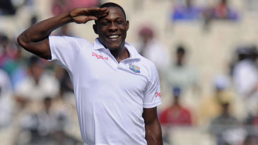 Sheldon Cottrell salutes towards the West Indies dressing room after dismissing Cheteshwar Pujara