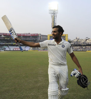 Rohit Sharma acknowledges the crowd after making a ton on his Test debut, India v West Indies, 1st Test, Kolkata, 2nd day, November 7, 2013