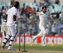 Mohammed Shami takes off after bowling Darren Sammy, India v West Indies, 1st Test, Kolkata, 3rd day, November 8, 2013